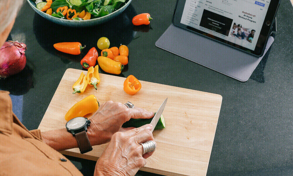 Cooking in kitchen with a tablet device